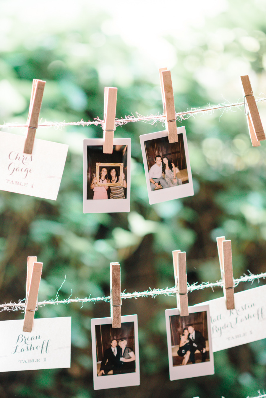 Escort-cards-and-polaroids-hang-from-clothes-line.full