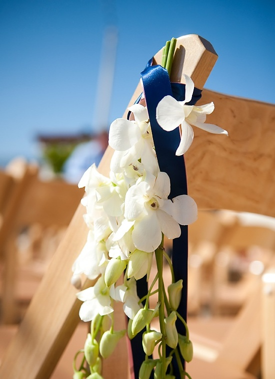 Santa Barbara outdoor wedding ceremony with simple ivory wedding flowers and navy blue ribbon