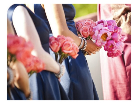 Navy blue bridesmaids' dresses, coral rose bouquets