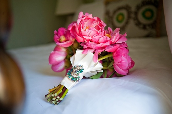 Bright pink peony bridal bouquet with Something Blue brooch