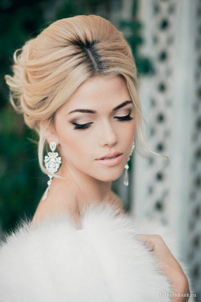 Glamorous-winter-bride-wearing-updo-and-chandelier-earrings.full