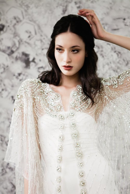 Beautifully beaded bridal cape for winter weddings