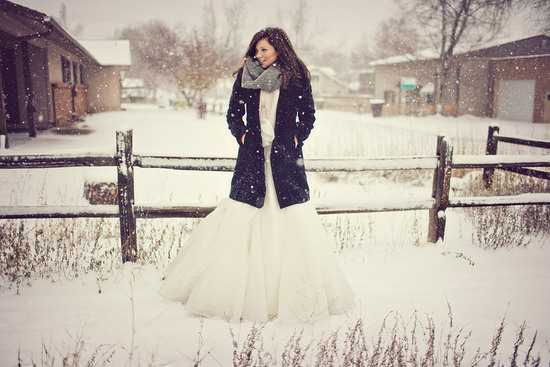 winter bride pairs fit and flare wedding dress with deep navy coat