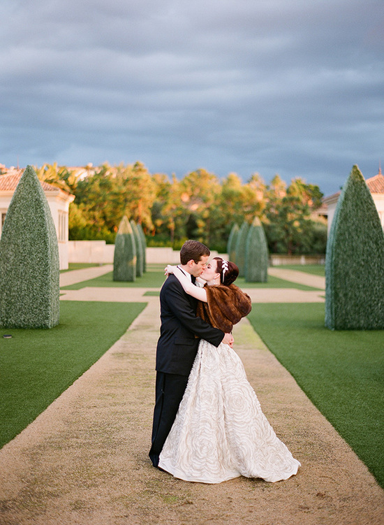 California bride wears brown fur stole with ball gown wedding dress