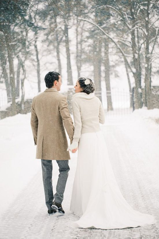 winter bride wears a fur trimmed wedding sweater