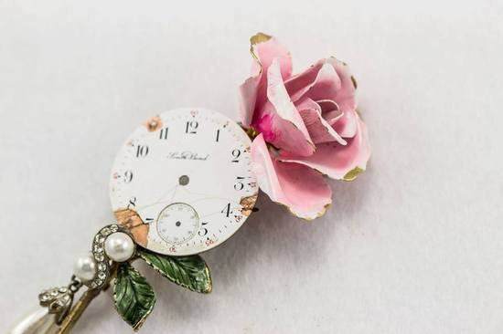 Vintage rose and clock grooms boutonniere