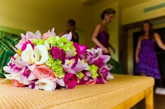 Vibrant tropical bridesmaids bouquets