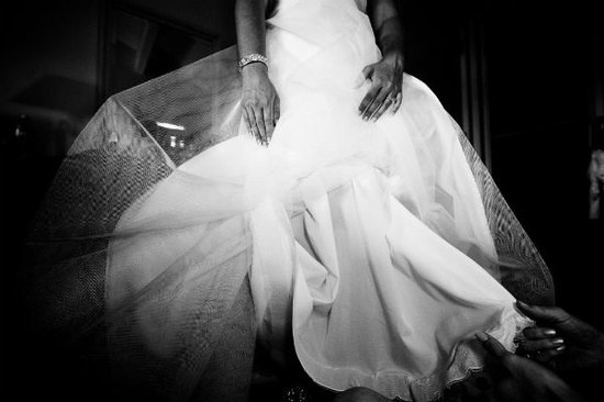 Artistic wedding photo of bride's ivory wedding dress with tulle underlay