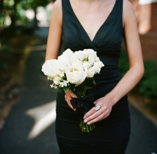 V-neck chic bridesmaid dress and white wedding bouquet