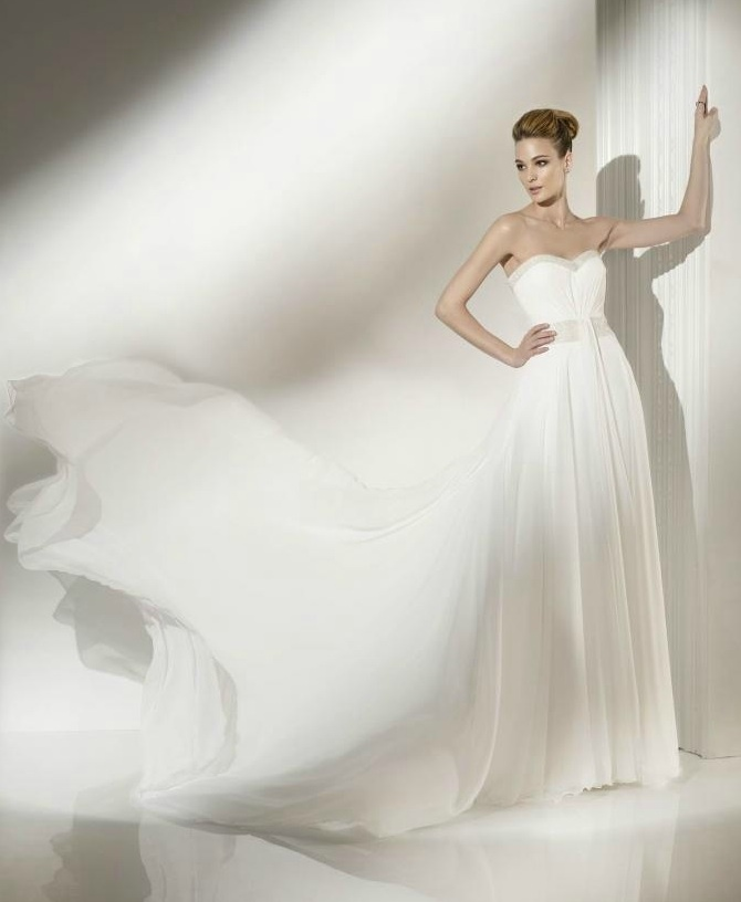 photo of Float Down the White Aisle with this Wedding Dress Designer!