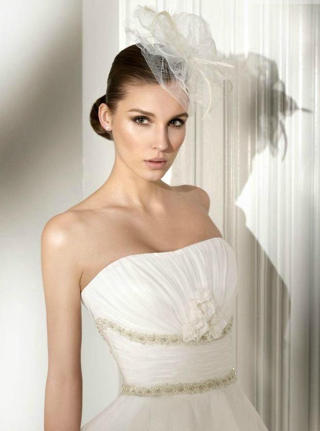 Strapless wedding dress with avant garde bridal headpiece