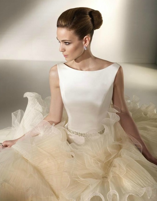 Ivory bateau neck wedding dress with ruffle-adorned skirt