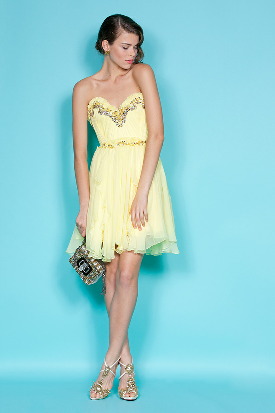 Buttery yellow sweetheart bridesmaids dress with gilded beading by Marchesa
