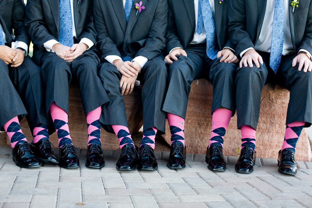 Groom and groomsmen wear funky pink and blue argile socks