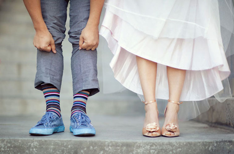 casual groom shows off funky socks and shoes