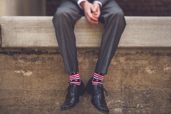 dapper groom wears star spangled socks