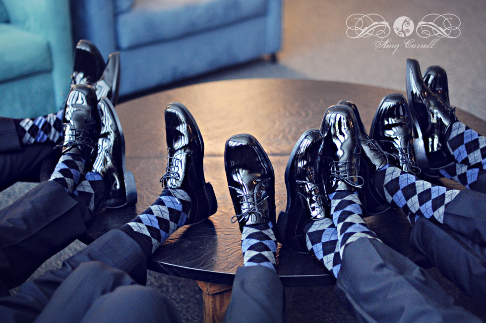 groomsmen show off shiny tux shoes and checkered socks