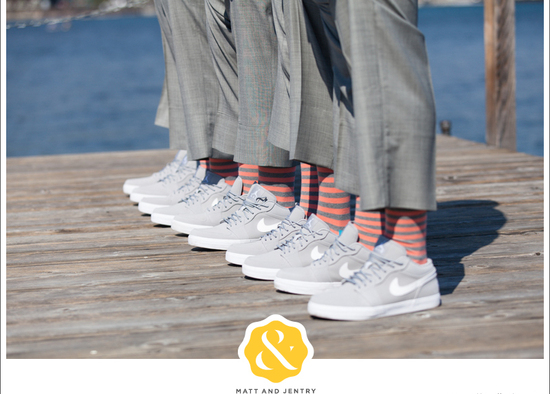groomsmen wear light gray nikes with striped socks