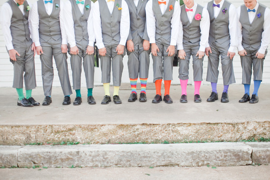 rainbow socks on dapper groomsmen in gray
