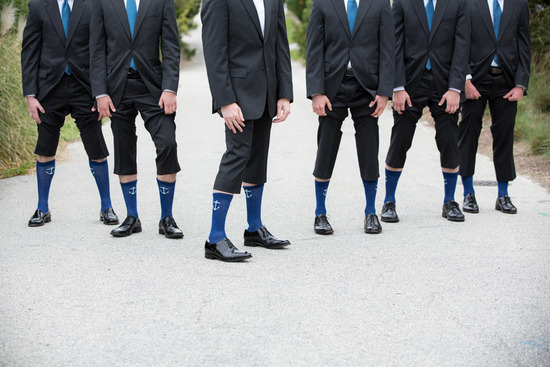 groomsmen show off matching nautical socks