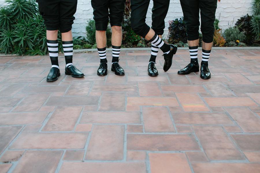 Groom-and-groomsmen-wear-funky-black-and-white-striped-socks.full