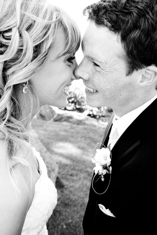 Blushing bride kisses her groom after saying I Do