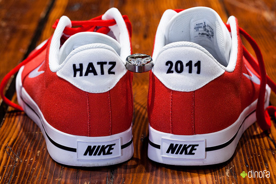 custom Nikes for groom hold wedding rings