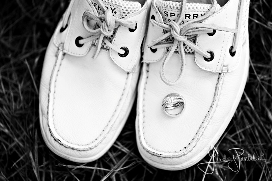 grooms white sperrys with wedding rings on top