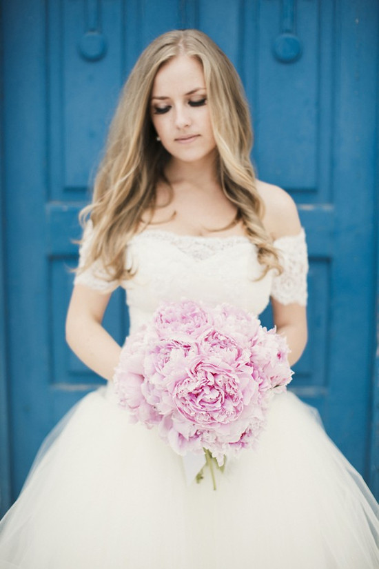 photo of romantic wedding bouquet of fluffy pale pink peonies