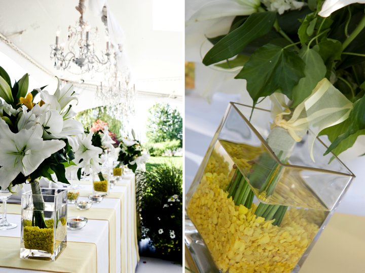 Tented wedding venue with luxe chandeliers and citrus-inspired wedding decor