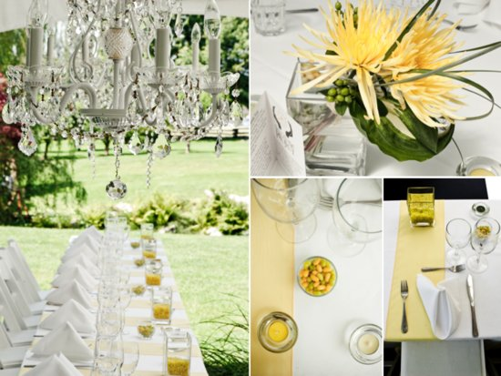 White wedding reception tent hung with chandeliers, adorned with yellow wedding flowers