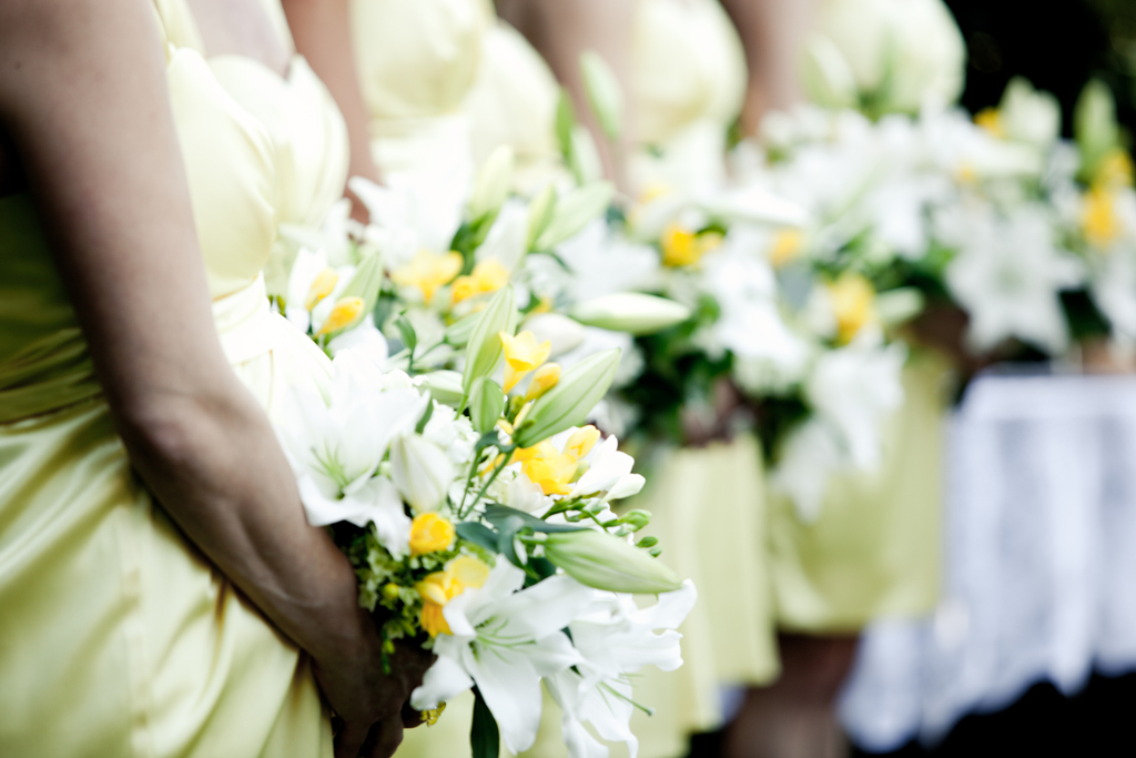 Ivory and yellow wedding flower bridesmaids' bouquets and mellow yellow bridesmaids' frocks