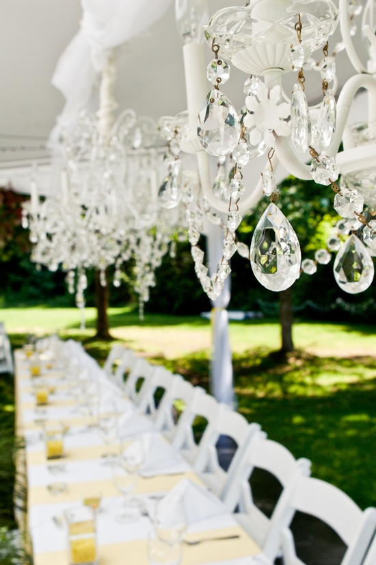 Outdoor summer wedding with white reception tent and sparkling chandeliers