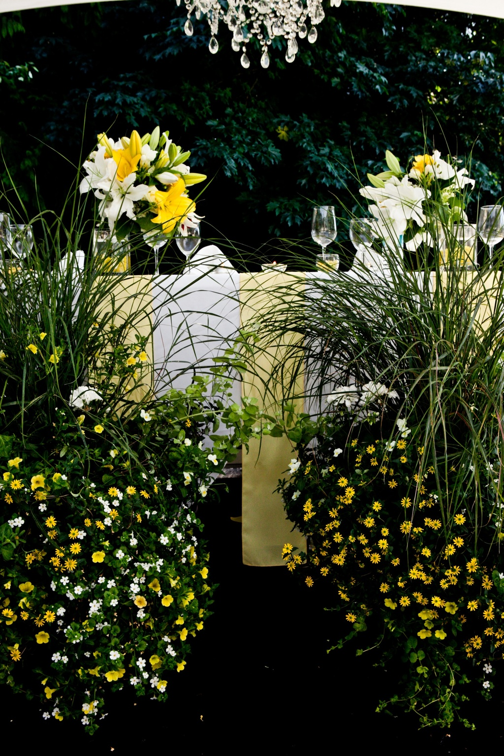Yellow, ivory and green wedding flowers at summer outdoor reception