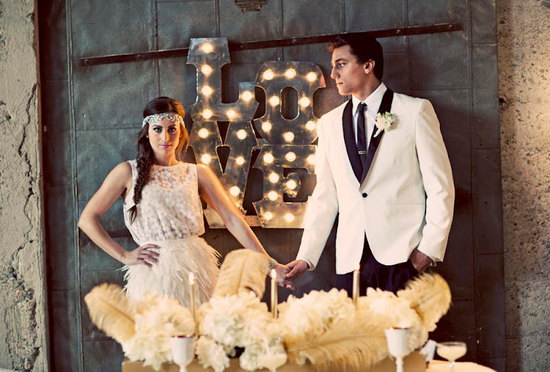 photo of vintage carnival wedding Love marquee sign