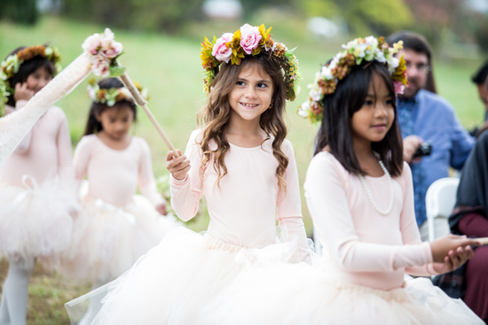 Flower girls with flower crowns and blush dresses