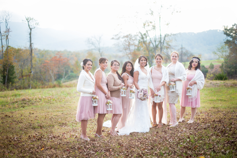 Mix_and_matched_bridesmaids_in_blush_dresses_and_with_lanterns_as_bouquets.full