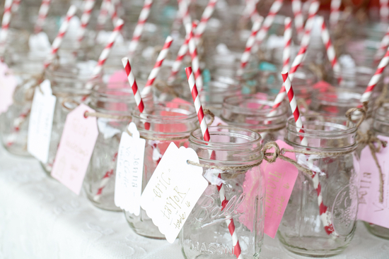 Personalized mason jar escort cards with straws