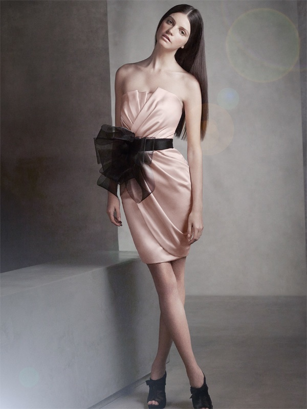 Strapless Vera Wang bridesmaid dress with dramatic black sash