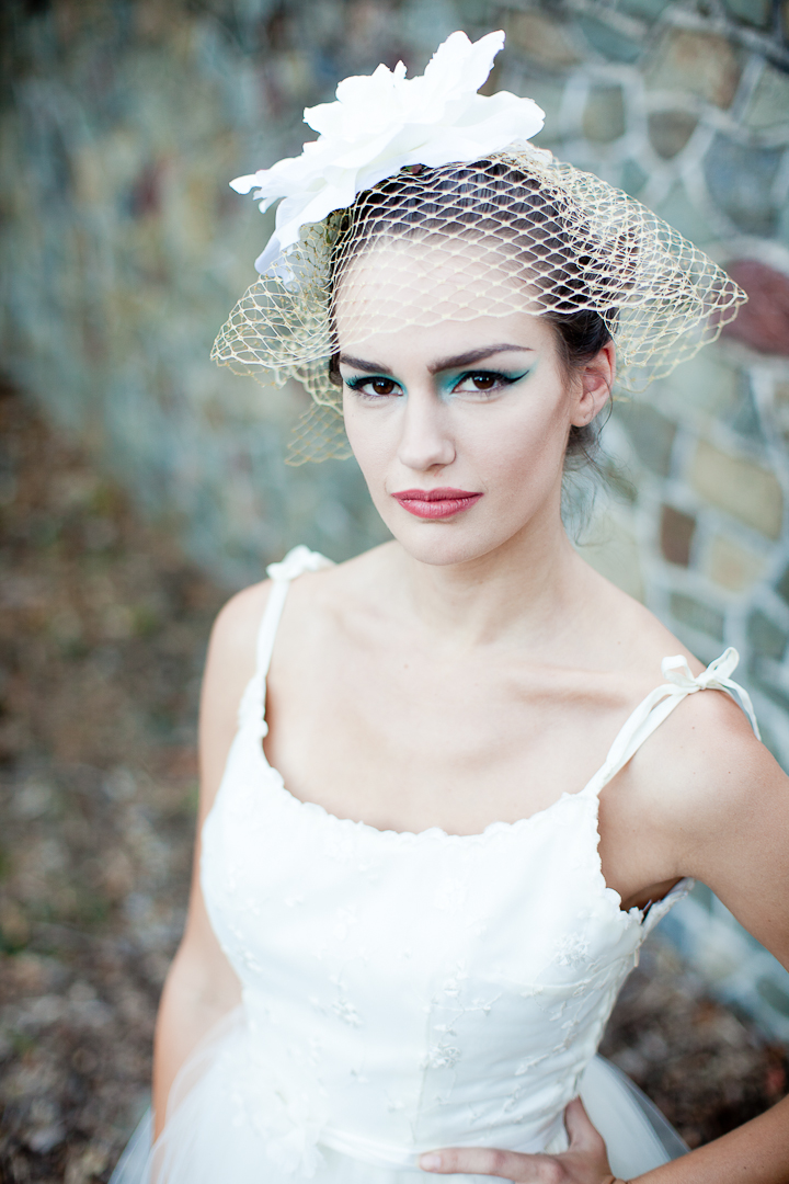 Dramatic bridal makeup and vintage birdcage veil | OneWed.com