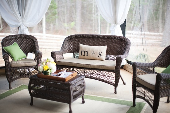 Wedding reception lounge area with monogrammed pillows and romantic draping
