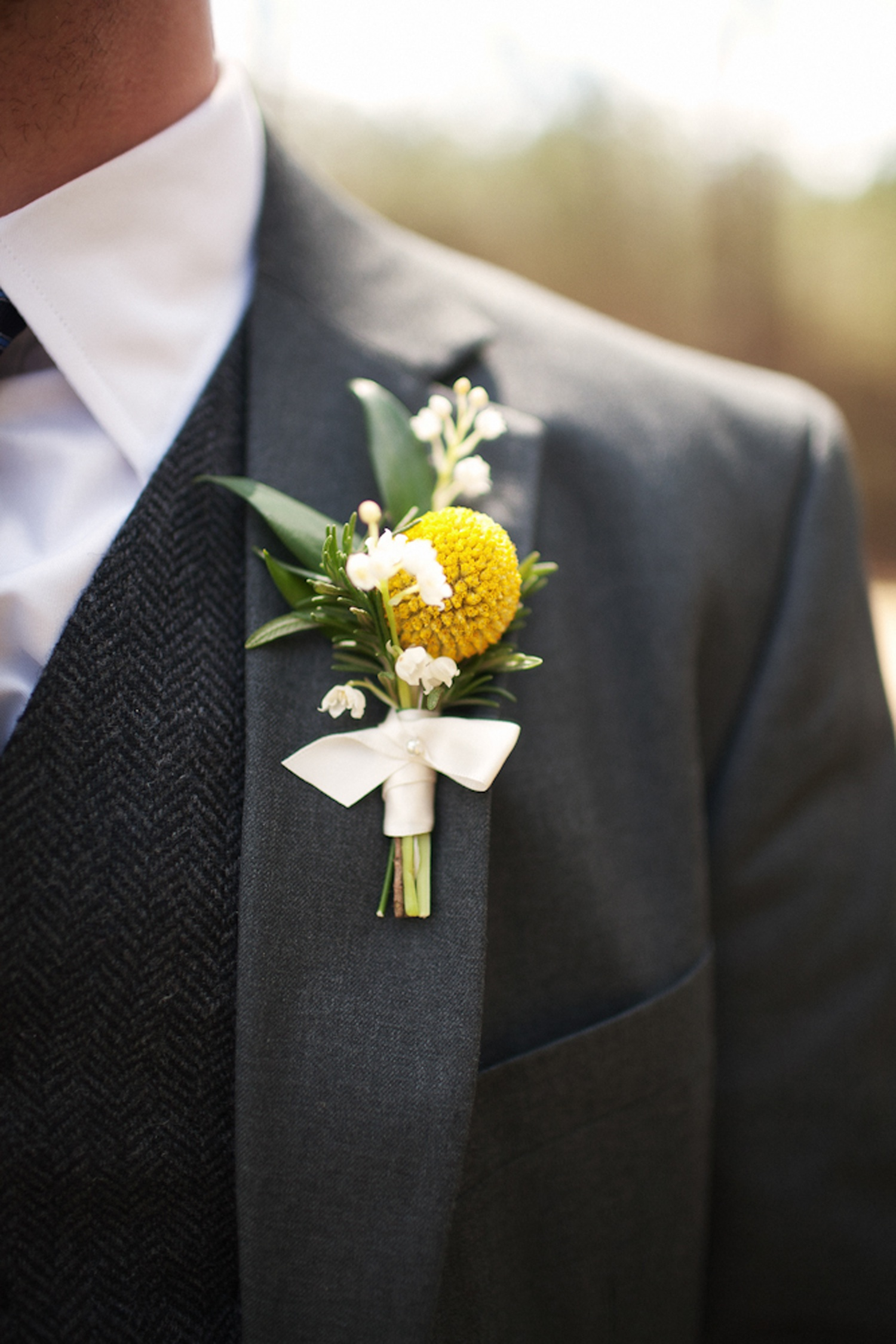 Wedding Flower Ideas For Groomsmen : Groom wears charcoal grey suit, yellow boutonniere OneWed.com