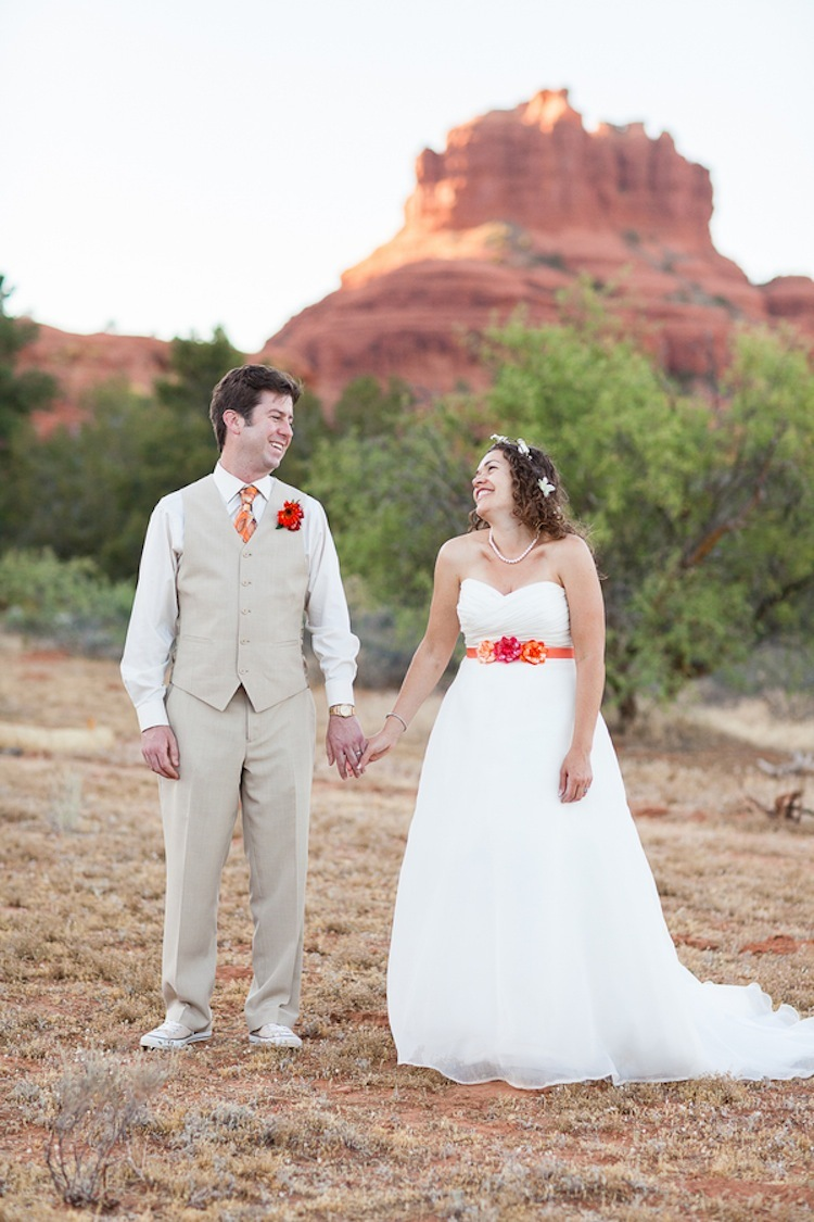 Real wedding couple in Sedona with bright florals