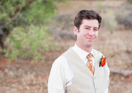 Sedona groom with bright red boutonniere