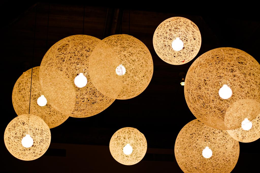 Romantic Beach Wedding Reception Venue With Sparkling Hanging Lanterns