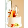 Beach-wedding-reception-classic-wedding-cake-fresh-flowers.square