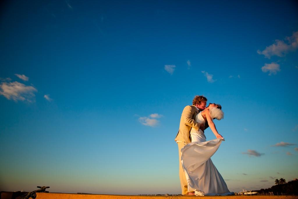 Real-weddings-beach-bride-simple-white-wedding-dress-groom-in-khaki-suit.full