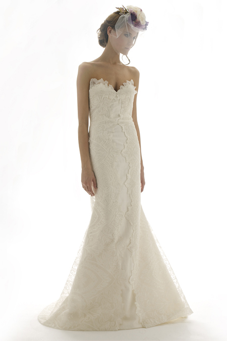 Vintage-inspired ivory deep sweetheart wedding dress with modified mermaid silhouette