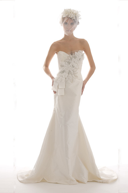 Stunning ivory mermaid strapless wedding dress with heavily embellished bodice