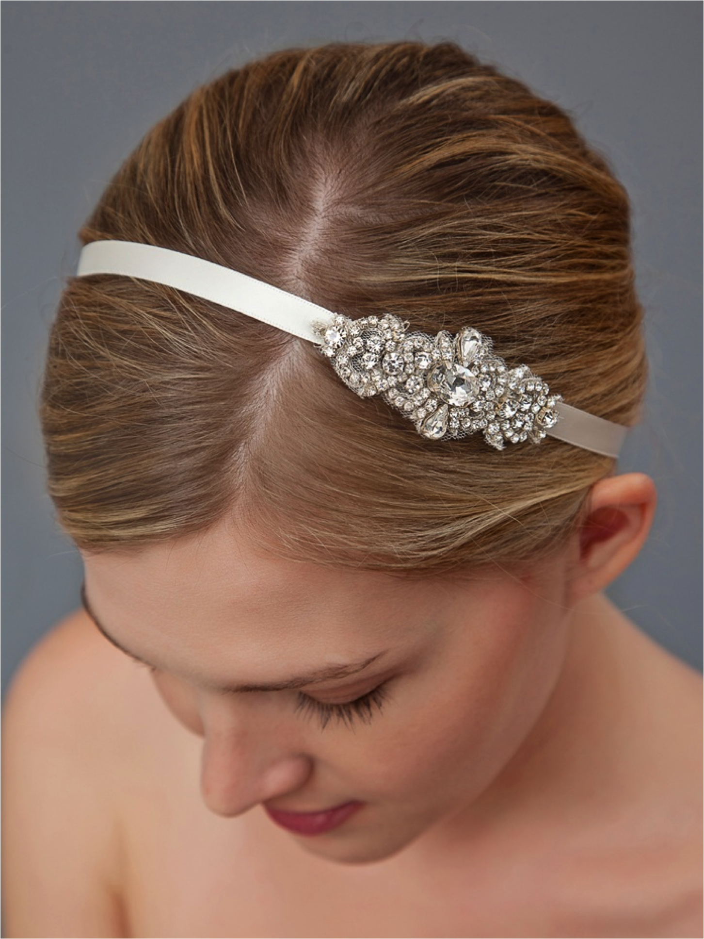 Chic bridal headband with crystal brooch for wedding updo | OneWed.com